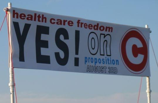 Supporters of Proposition C displayed this banner Wednesday at a rally in St. Charles. (photo: Maria Altman)