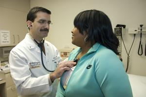 Dr. Castro examines patient Marsha D. Mitchell.