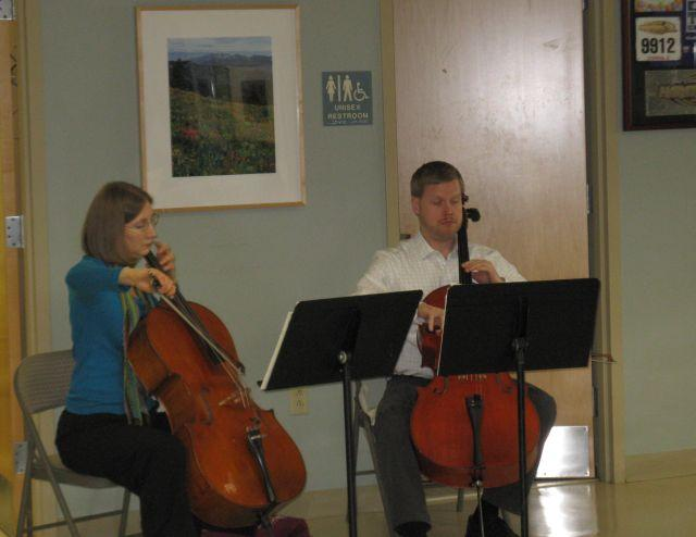 St. Louis Symphony cellists Anne Fagerburg and Bjorn Ranheim play a music therapy concert at the Saint Louis University Cancer Center on Feb. 27.
