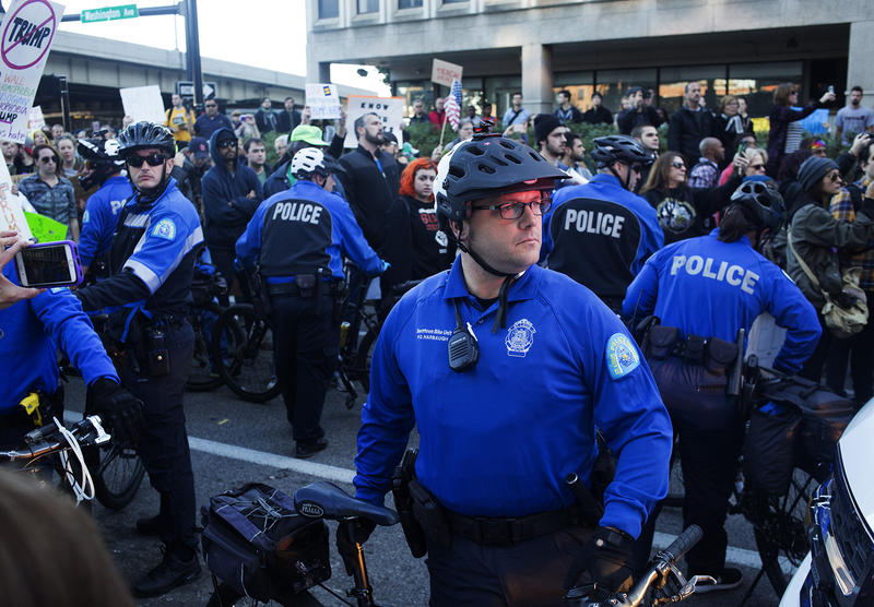 St. Louis city police officers attempt to block demonstrators during an anti-Trump rally in downtown St. Louis in November 2016.