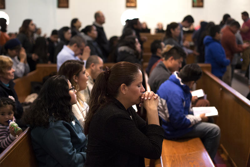 Parishioners pray during a Sunday morning mass at Our Lady of Guadalupe in Ferguson on Nov. 19, 2017.