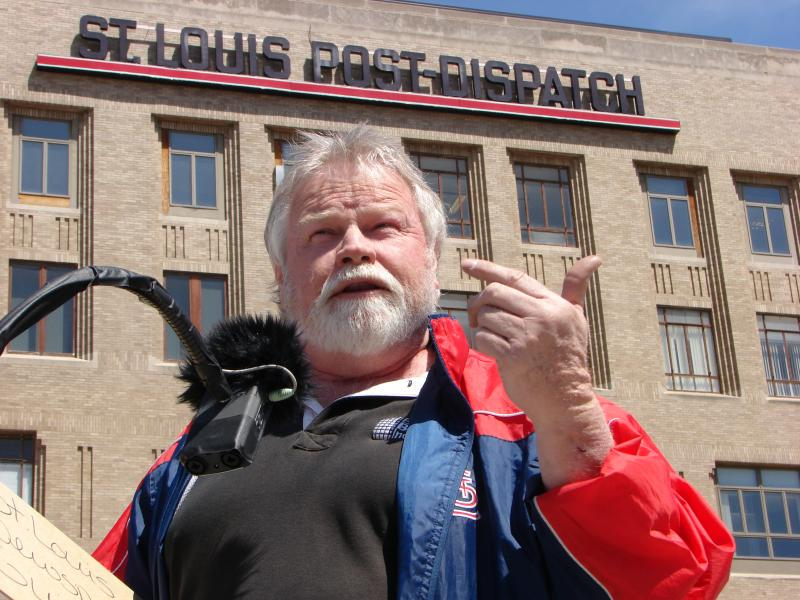 St. Louis Post-Dispatch retiree, Richard P. Hughes, says the paper's parent company Lee Enterprises cut his health care benefits.