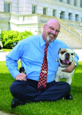 "Mo. state Sen. Kevin Engler, R-Farmington with his late dog, Winston. The dog often accompanied Engler to political functions and parades. Engler said Winston was ""part of [his] softer side."""