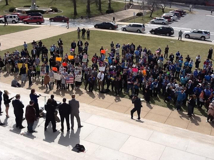 About 300 people rallied outside the Mo. Capitol against 2 immigration-related bills.