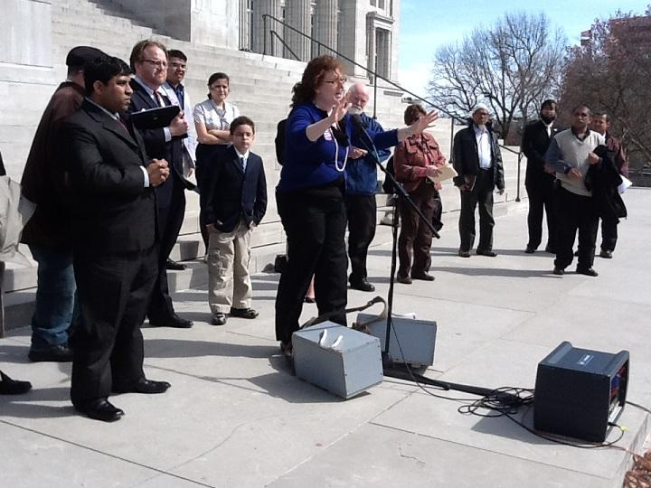 Vanessa Crawford, Exec. Dir. of MIRA, address the crowd outside the Mo. Capitol.
