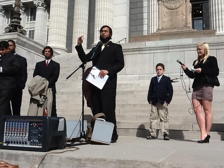 Faizan Syed from the Mo. Chapter of CAIR adresses the crowd outside the Mo. Capitol.