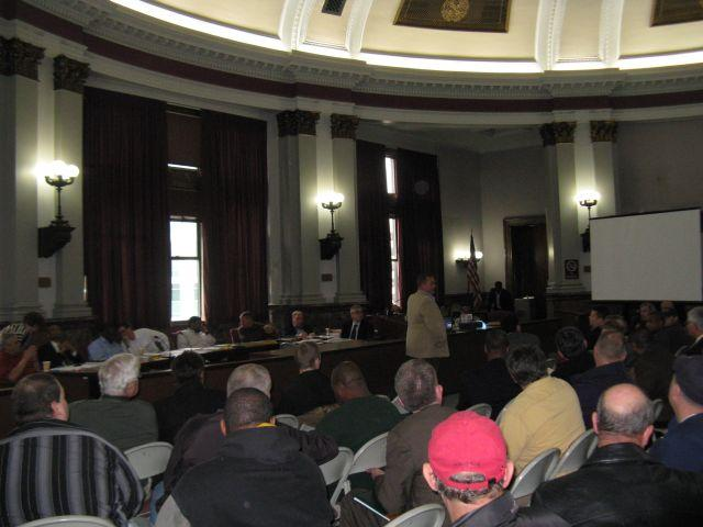 Union president Chris Molitor (in tan jacket) updates the Public Safety committee and others on March 8, 2012 on the progress of negotiations over changes to firefighter pensions.