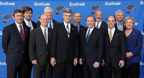 Tom Stillman, NHL Commissioner Gary Bettman, and members of Stillman's ownership team pose after Stillman is introduced as the eighth owner in Blues history.