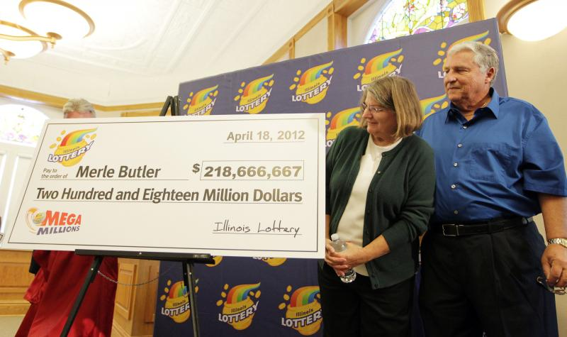 Butler and his wife Patricia get a look at an oversized check of their winnings in the Mega Millions Quick Pick during a press conference in Red Bud, Illinois on April 18, 2012.