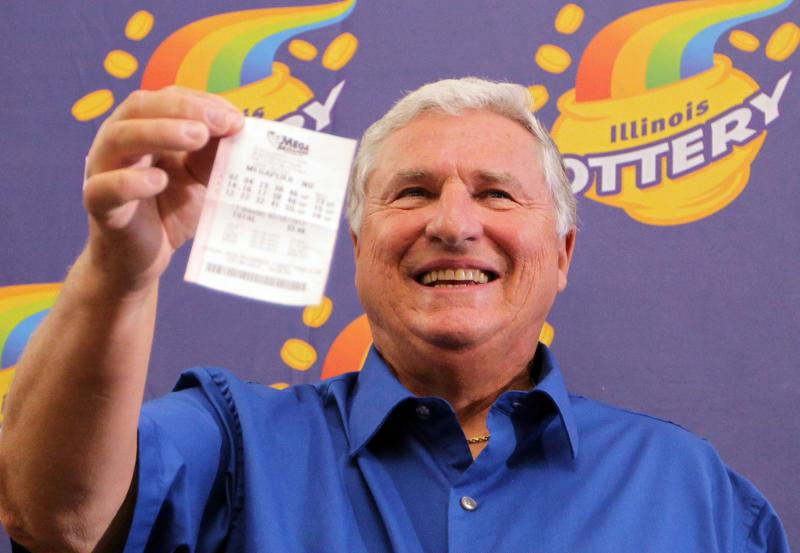 Merle Butler shows off his winning Mega Millions Quick Pick ticket that netted him nearly $111 million (after taxes) during a press conference in Red Bud, Ill. on April 18, 2012. Butler is a retired computer analyist from Red Bud.