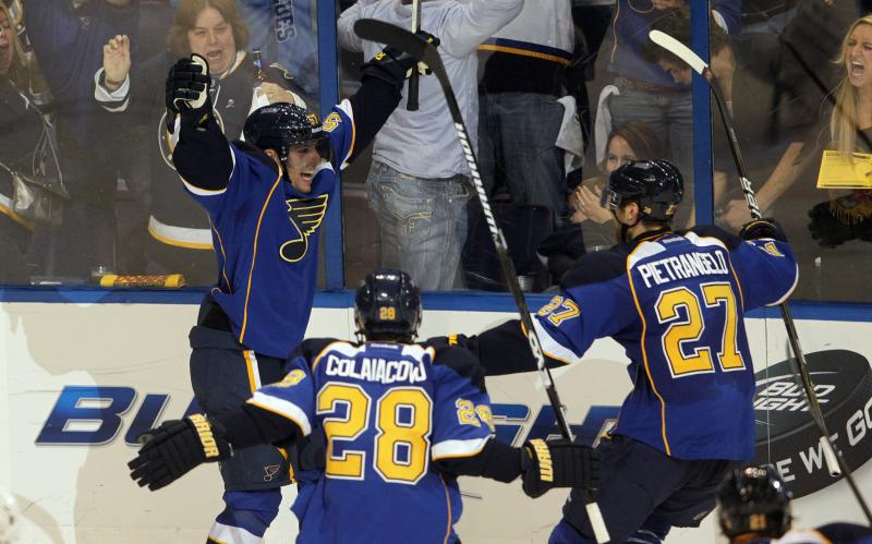 Forward David Perron (arms raised) celebrates his game-winning goal with defensemen Alex Pietrangelo (27) and Carlo Colaiacovo (28).
