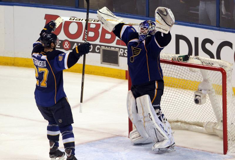 Goalie Brian Elliott and defenseman Alex Pietrangelo celebrate the Blues' 3-1 victory and and their first playoff series win since 2002.