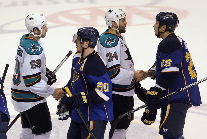 St. Louis Blues forwards Alex Steen (20) and Chris Stewart (25) shake hands with the San Jose Sharks following the Blues' 3-1 series-clinching win.