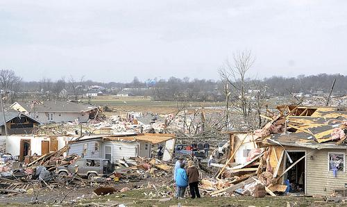 Residents take in some of the damage after a severe storm hit in the early morning hours on February 29, 2012, in Harrisburg, Ill.