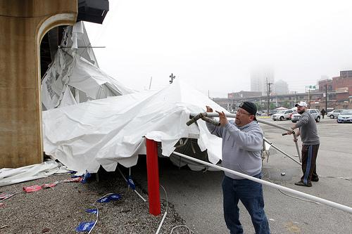 Approximately 100 people were injured and one killed after officials said straight-line winds whipped through and collapsed a large tent outside Kilroy's Sports Bar, near Busch Stadium, on April 28, 2012.