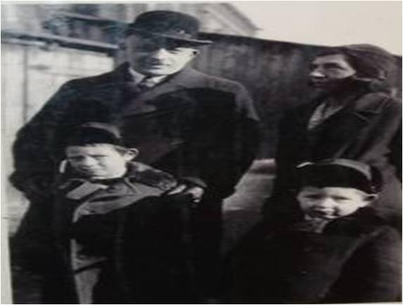 Mendel Rosenberg's family. Pictured are Shimon Rosenberg (father), Samuel Rosenberg (brother), Recha Rosenberg (mother) and Mendel. Shimon and Samuel were both killed during the Holocaust. Mendel and his mother survived.