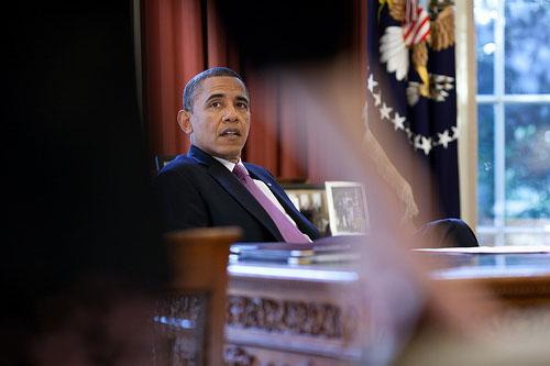 President Barack Obama talks with White House Counsel Kathryn Ruemmler in the Oval Office, Jan. 18, 2012.