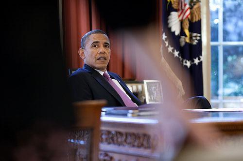 President Barack Obama talks with White House Counsel Kathryn Ruemmler in the Oval Office, Jan. 18, 2012.