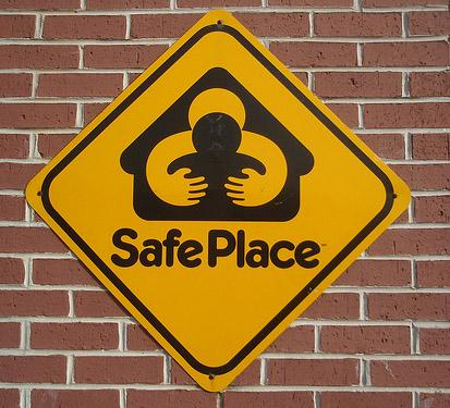 "A sign designating a location as a ""safe place"" for women to surrender newborns within a certain period of time, no questions asked."