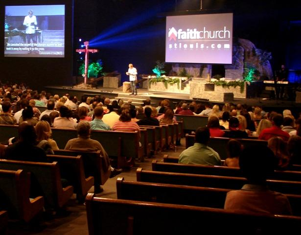 Pastor David Crank promotes his church's website during an Easter Sunday sermon at Faith Church St. Louis in Sunset Hills.