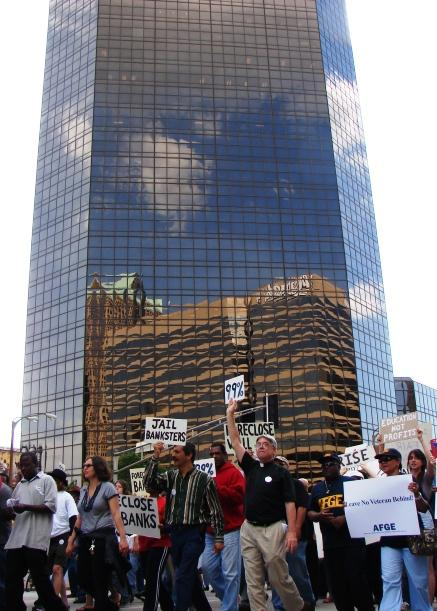 Several hundred protesters demonstrated outside Bank of America's regional headquarters in downtown St. Louis Tuesday.