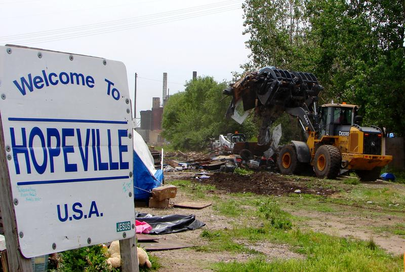 Hopeville, a homeless camp near the St. Louis riverfront, is razed on May 11, 2012.