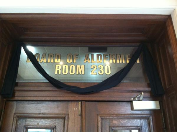 Black bunting marks the entrance to the chambers of the St. Louis Board of Aldermen on the morning of August 1, 2012 to mark the death of Ald. Gregory Carter in a vehicle accident just hours earlier.