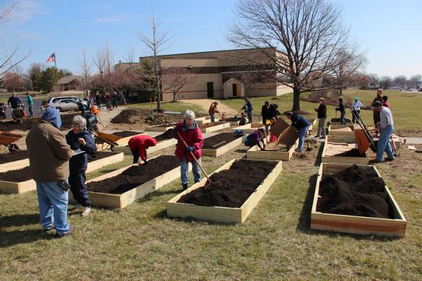 Volunteers install a community garden at the Prairie Commons Branch of the St. Louis Public Library District on Saturday, March 23.