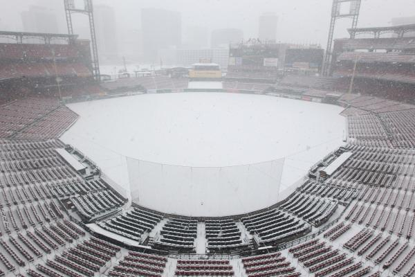 A heavy snow storm falls on Busch Stadium in St. Louis on March 24, 2013.