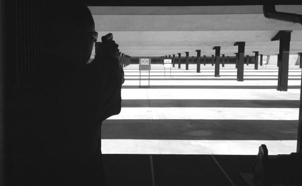 A.J. Chetta fires a Glock at the Jay Henges Shooting Range in St. Louis.