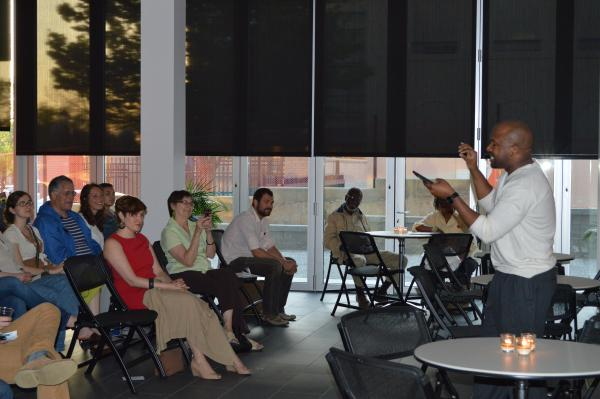 """Local poet MK Stalling recites a poem at """"The Poetry of Me,"""" held on April 30 at UMSL at Grand Center. The event invited participants to lose their racial baggage and define their personal identity."""