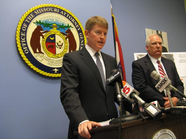 Missouri Attorney General Chris Koster speaks to reporters about his preliminary agreement with Republic Services to address problems at the Bridgeton Landfill. Assistant Attorney General Joseph Bindbeutel looks on.