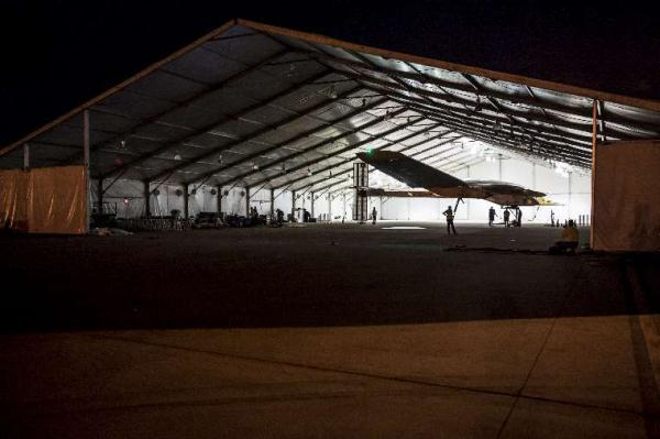 Solar Impulse is towed out of the tent onto the runway in Dallas on its way to St. Louis.