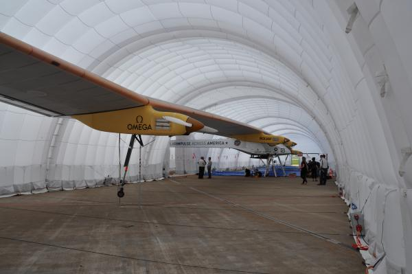 Solar Impulse rests in its inflatable hangar at Lambert Airport after its landing on June 4, 2013.