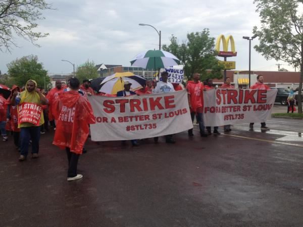 """Supporters of the """"STL Can't Survive on $7.35"""" fast food campaign march down Lindell Boulevard on May 9."""