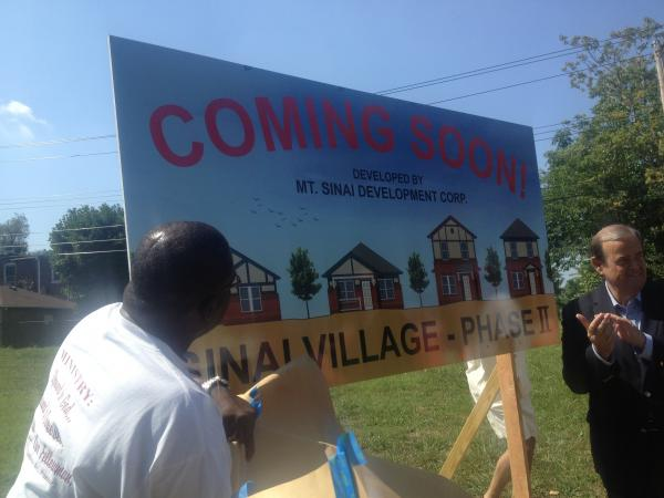 Pastor Herman Watson, left, and former U.S. Congressman Jerry Costello at the dedication ceremony. Land has been secured to begin phase two of Sinai Village in East St. Louis, which will build 30 more homes in the Winstanley Neighborhood.