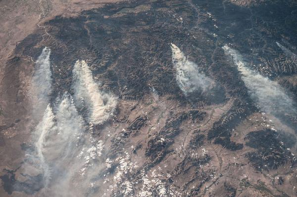 This aerial photograph of this year's Idaho wildfires shows large smoke plumes traveling eastward.