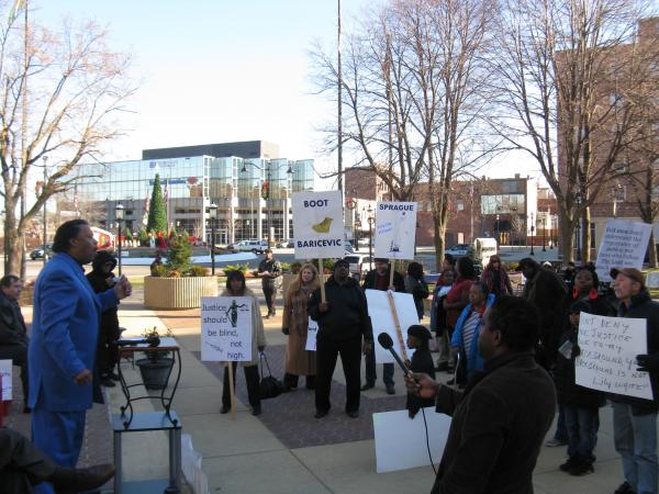Lee Griffin, the chair of Metro East Citizens for Social and Economic Progress, addresses protesters outside St. Clair County headquarters on Dec. 27, 2013.