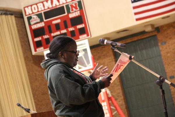 Kim Morris speaks to state education officials during a meeting at Normandy High School on Dec. 11, 2013.