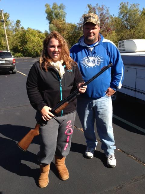"""Sixteen-year-old Mackenzie Wilson and her father Doug Wilson pose with her shotgun. On this day they had a """"shoot off"""" to determine which of them had won the round after a tie. """"And I beat her,"""" Doug said with a chuckle, """"but she does good . She's won quite a few times."""""""