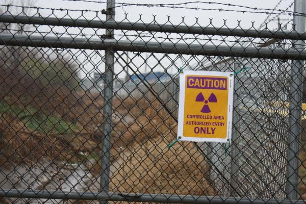 This radiation warning sign is posted on the perimeter fence of the West Lake Landfill in Bridgeton, Mo.