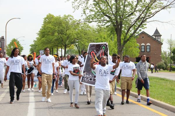 Around 400 students, community leaders and public officials rallied for peace and marched down Riverview Boulevard near the Northwest Academy of Law High School.