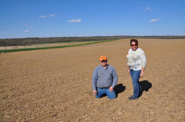 Shelley Finfrock (standing) and her son Marvin farm about 8,000 acres of corn and soybeans. They already buy Monsanto's genetically-engineered seeds.