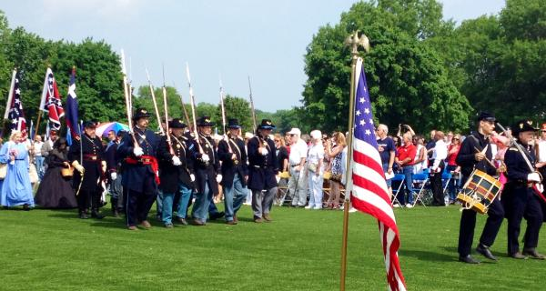 A memorial procession Monday commemorates fallen soldiers and those currently serving at war at the Jefferson Barracks National Cemetery.