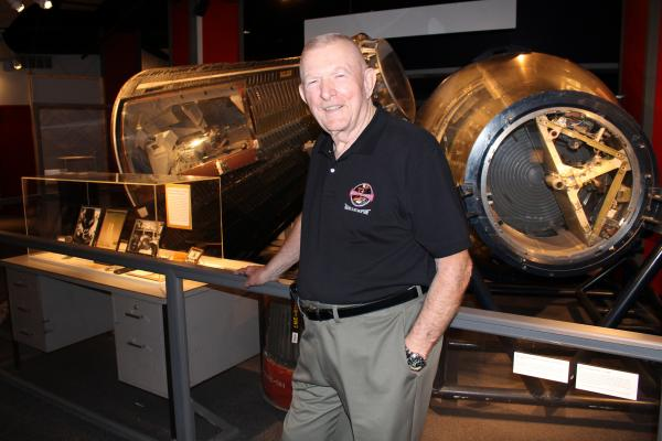Gene Kranz poses in front of the Mercury #19 space capsule at the Saint Louis Science Center in May. The capsule was one of 20 spacecraft built in St. Louis by the McDonnell Aircraft Corporation.