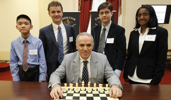 Left to Right. Jeffrey Xiong, Kayden Troff, Sam Sevian and Ashritha Eswaran, with Garry Kasparov.