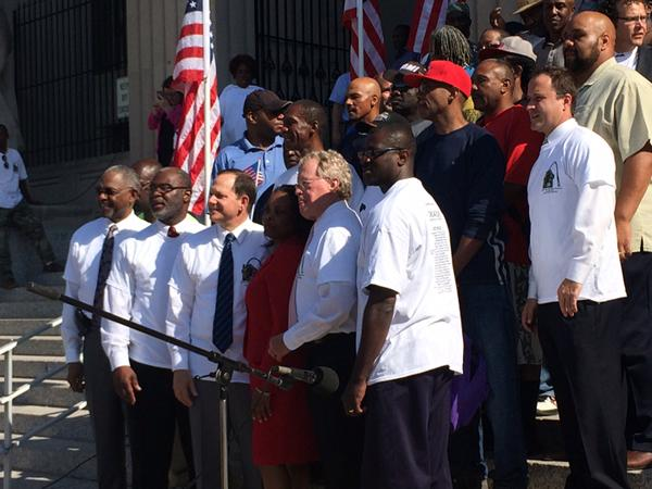 Veterans, city officials and volunteers pose for a photograph before beginning the one day push to end homelessness among veterans in the city of St. Louis.