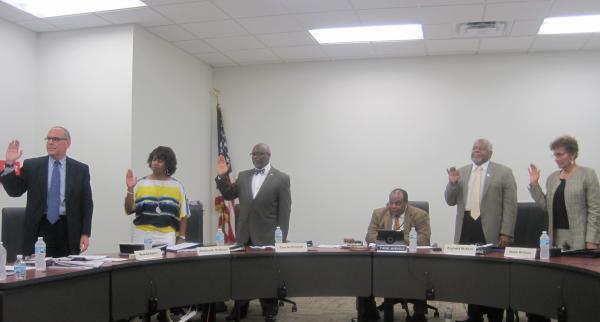 Richard Ryffel, Andrea Terhune, Charles Pearson, Superintendent Ty McNichols, Reginald Dickson and Sheila Williams take their oath.