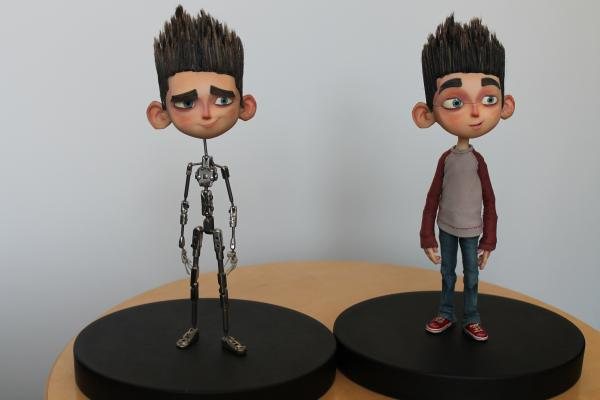 "LAIKA animation supervisor Brad Schiff displays two of the puppets used to film ""ParaNorman."" ""We design the faces in the computer first, so it's modeled in the computer, all of the expressions are built in the computer. Then they're printed out on a 3-D printer."""