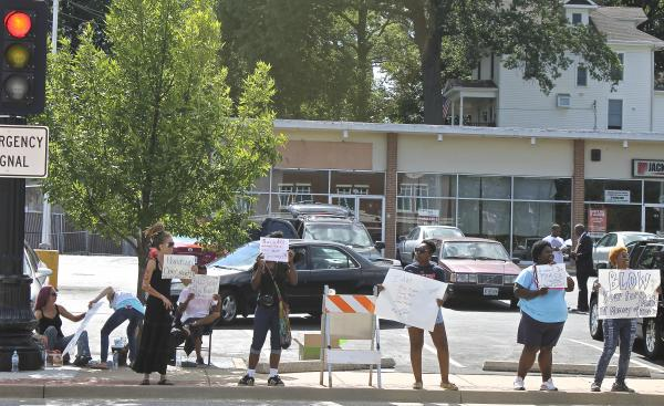 Protesters across from the police department.